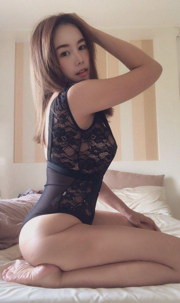 Sexy Flight Attendant From Air Asia In Black Lingerie Sitting On Bed