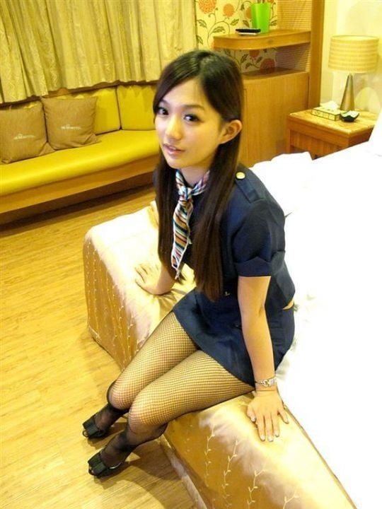 Taiwan Flight Attendant Sitting On Bed Before Sex