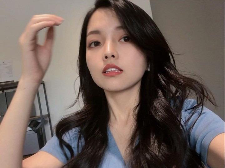 Cute Asian Instagram Model taking a selfie in blue shirt